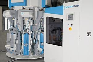"""<div class=""""bildtext"""">Turbinen-Abfüllmaschine auch in Reihenbauweise # Turbine filling machines with inline design</div>"""
