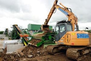 "<div class=""bildtext"">Bauschutt Aufbereitung in Großbritannien • Building rubble processing in Great Britain</div>"