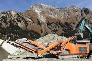 """<div class=""""bildtext"""">1 Einsatz des R1100DS / R1200D Prall- und Backenbrecher im Kieswerk Casaccia • Use of the R1100DS/R1200D Impact/Jaw Crusher in the quarry Casaccia</div>"""