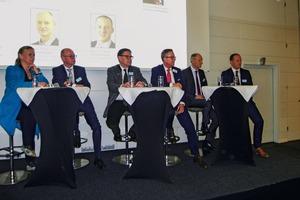 """<div class=""""bildtext"""">Podiumsdiskussion zur Mantelverordnung:&nbsp; Birgit Gehr, Blues Bay, Logistik&nbsp;&nbsp;&nbsp;&nbsp;&nbsp;&nbsp; Umwelt &amp; Entsorgungs Systeme GmbH, München; Berthold Heuser, REMEX Mineralstoff GmbH, Düsseldorf; Dr.-Ing. Klaus Mesters, KM GmbH für Straßenbau und Umwelttechnik, Bochum; Dr. Tilmann Quensell, Otto Dörner Kies und Deponien GmbH &amp; Co. KG Hamburg; Dipl.-Ökon. Hans-Joachim Rauen, Hermann Rauen GmbH &amp; Co. KG Mühlheim a. d. Ruhr; Michael Weiß, Johann Ettengruber GmbH, Dachau (von links) # Panel discussion on the Umbrella Ordinance: Birgit Gehr, Blues Bay, Logistik Umwelt &amp; Entsorgungs Systeme GmbH, Munich; Berthold Heuser, REMEX Mineralstoff GmbH, Düsseldorf; Dr.-Ing. Klaus Mesters, KM GmbH für Straßenbau und Umwelttechnik, Bochum; Dr. Tilmann Quensell, Otto Dörner Kies und Deponien GmbH &amp; Co. KG, Hamburg; Dipl.-Ökon. Hans-Joachim Rauen, Hermann Rauen GmbH &amp; Co. KG, Mühlheim a. d. Ruhr; Michael Weiss, Johann Ettengruber GmbH, Dachau (from left)</div>"""