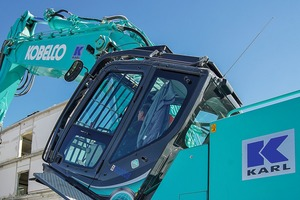 "<div class=""bildtext"">3 One of the ""extras"" implemented by EMB Baumaschinen is the tilt function of the Kobelco series cab, which noticeably relieves the excavator operator even when working at low heights</div>"
