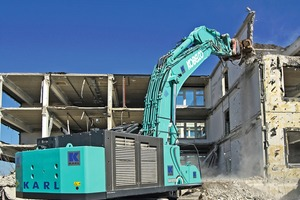 "<div class=""bildtext"">2 The multi-storey reinforced concrete structures at BMW plant 01.01 in Munich, which the Kobelco SK850LC-10E is demolishing in primary demolition, reach a maximum height of 15&nbsp;m</div>"