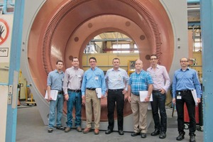 "<div class=""bildtext"">2 The project team from Siemens and ThyssenKrupp in front of the stato</div>"