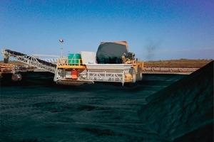 Crawler tracked mobile reclaim hopper feeding coal to overland conveyor<br />