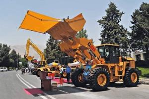 """<div class=""""bildtext"""">Aussteller auf der internationalen Fachmesse für Bau- und Bergbau in Teheran • Exhibitor at the international trade fair for construction and mining in Tehran</div>"""